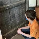 Math practice on Tavern door